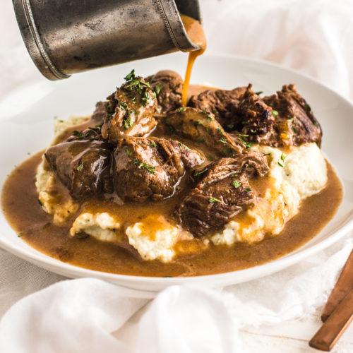 Beef Tips over cauliflower mash and gravy