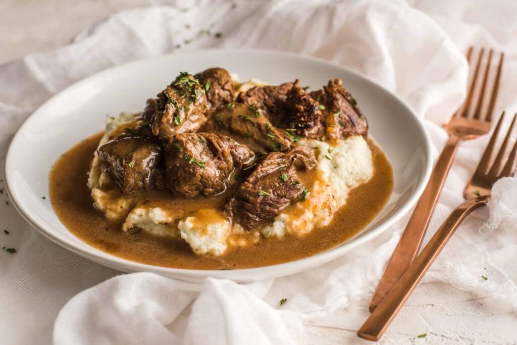 beef tips and gravy over cauliflower mash