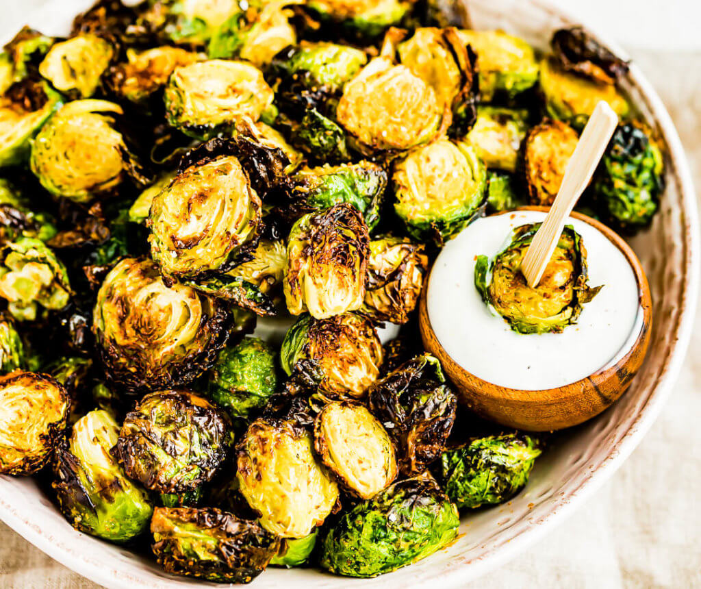 Air Fryer Brussels Sprouts dipped in ranch dressing