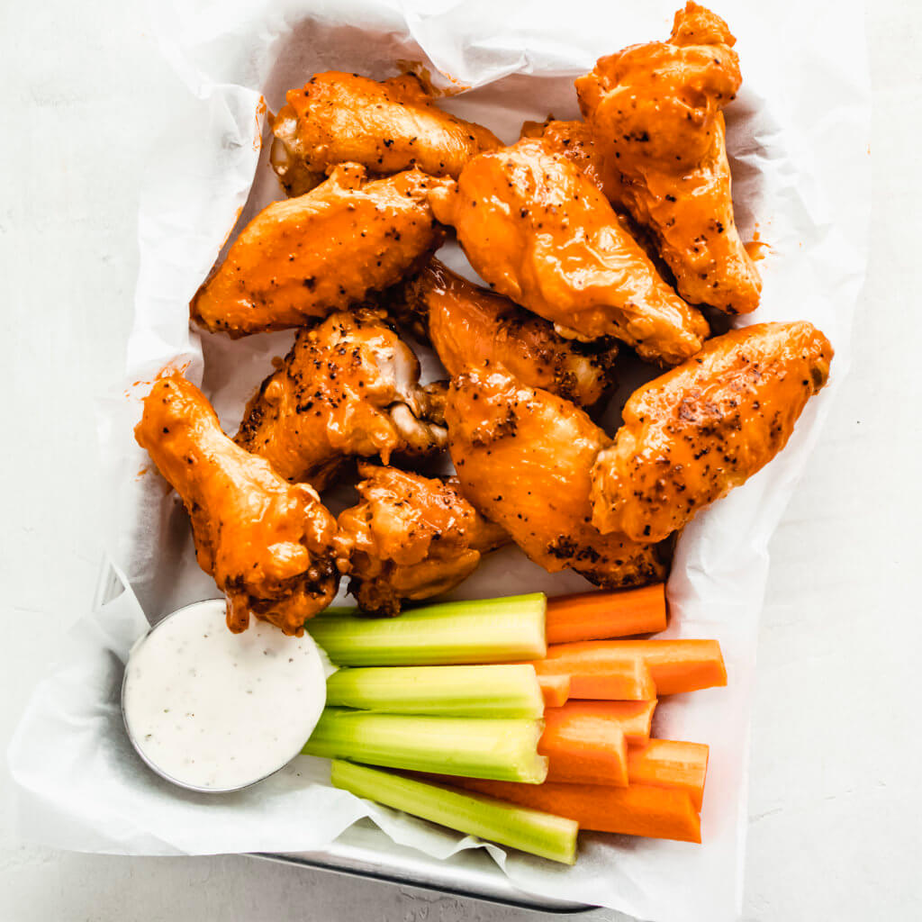 Chicken wings tossed in buffalo sauce with ranch dressing and carrots and celery.