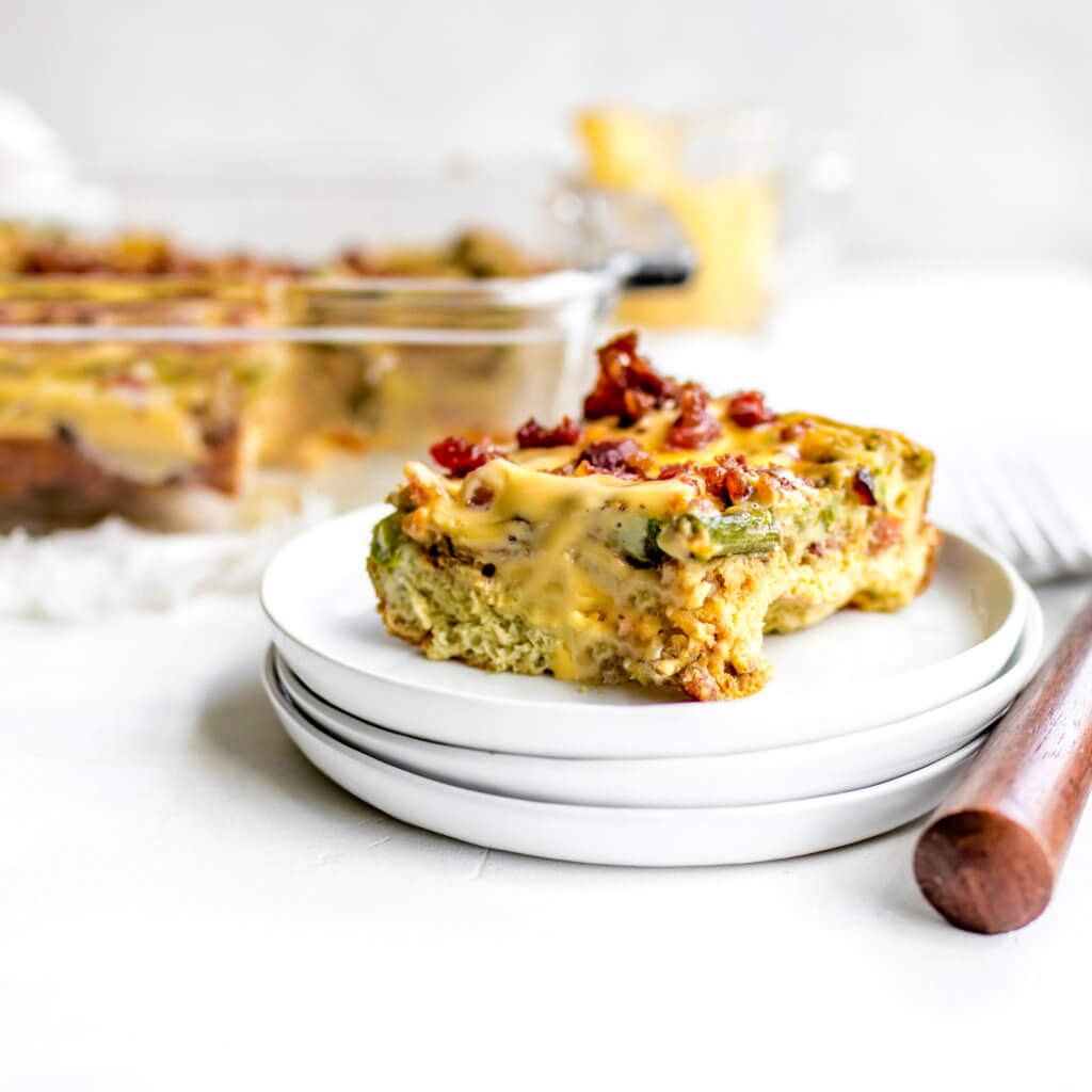 A slice of eggs Benedict casserole on top of plate with fork