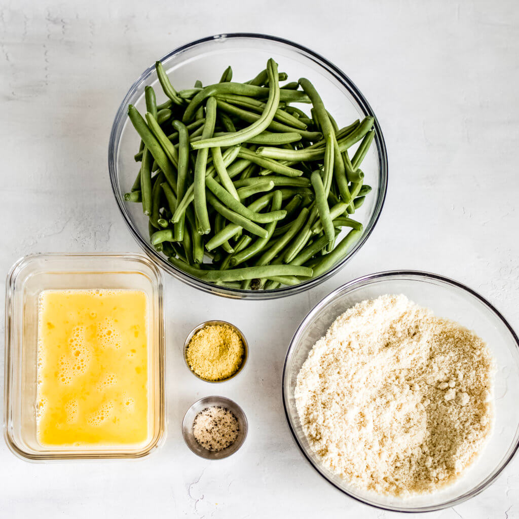 Eggs wash, almond flour, green beans, nutritional yeast, garlic and onion powder.