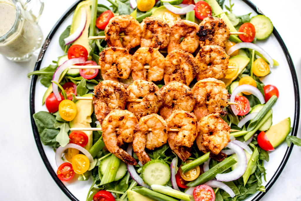 A crisp salad topped with blackened shrimp and drizzled with Citrus Herb Dressing