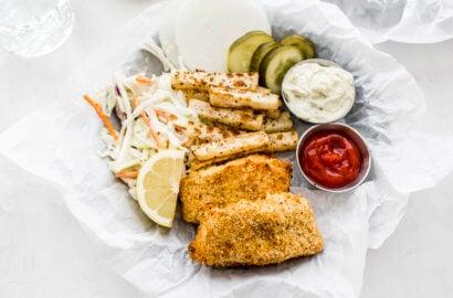 Crispy cod fillets, ranch coleslaw, jicama chiips, pickles, homemade tarter sauce, and ketchup