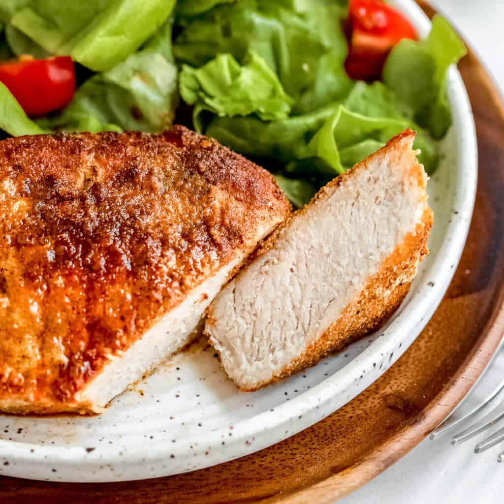 A close up photo of the pork chop cut in half