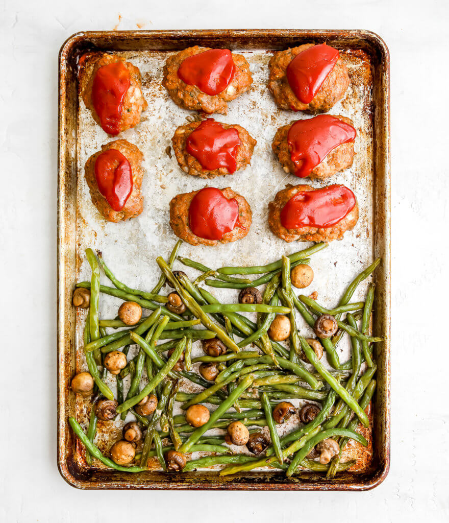 Meatloaves on a sheet pan with green beans and mushrooms