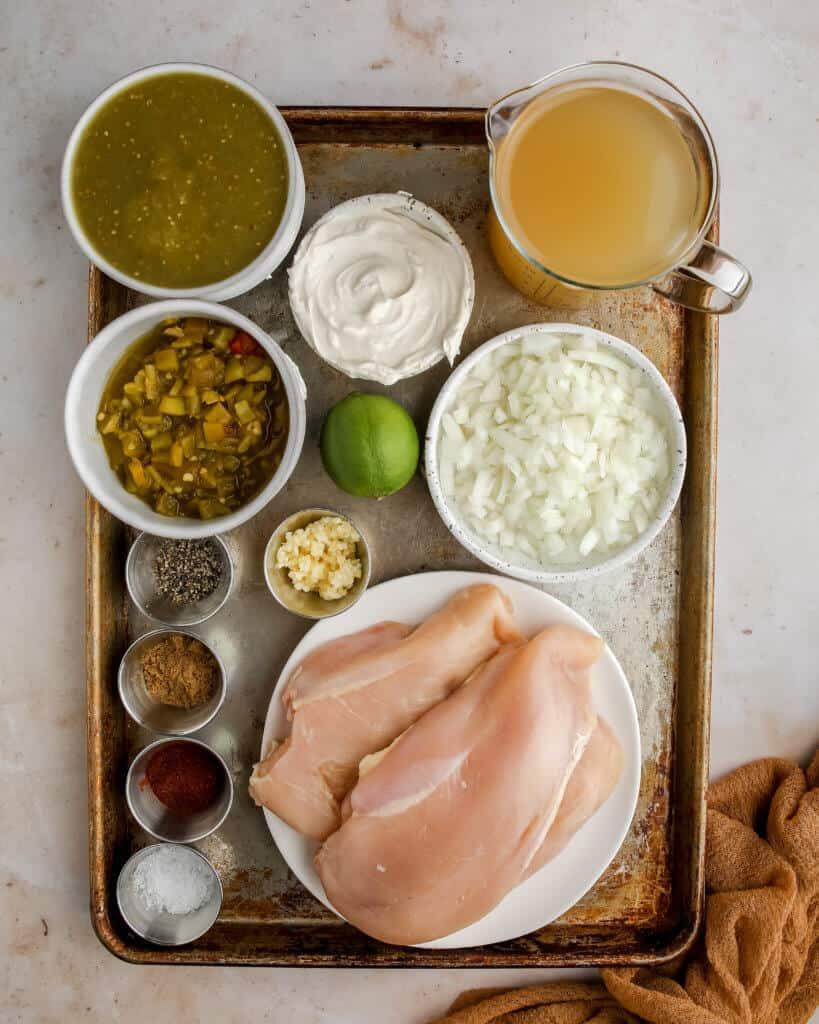 Salsa Verde Chicken Soup ingredients on a baking sheet
