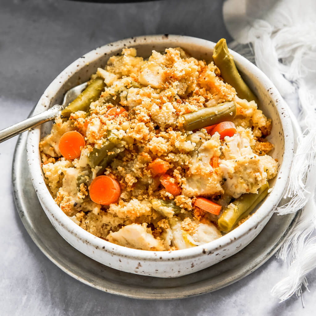 Chicken Pot Pie Casserole in a small bowl with a fork